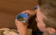 A Child Drinking Coffee