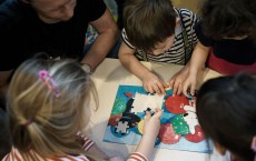 Kids playing with puzzles.