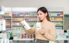 Woman choosing vitamins and siupllements