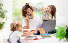 Mother working from home with kids.