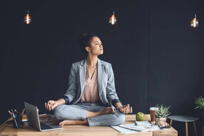 african american businesswoman mediating in office